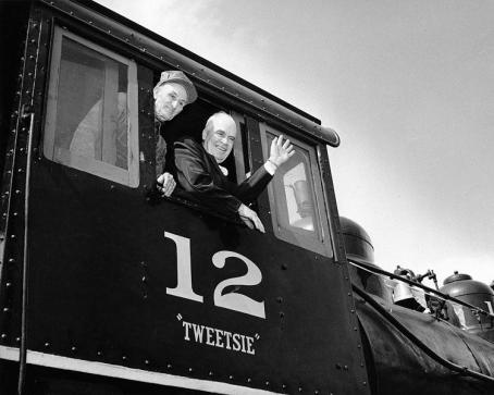 Gov. Luther Hodges waves from the Tweetsie engine in 1956. Image from the N.C. Museum of History