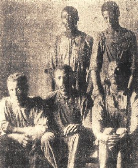 Jack Dillingham (seated on left), Nease Gillespie (seated on right) and John Gillespie (back row on the right). Image from A Game Called Salisbury.