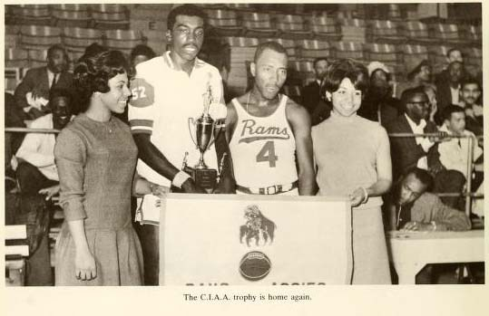 """Earl """"The Pearl"""" Monroe and others bring home the CIAA trophy in 1967."""