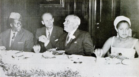 President and Mrs. Touré (far left and right) have dinner with Governor Luther Hodges (center right) in Chapel Hill. A French interpreter (center left) is also pictured. Image from Ebony Magazine.
