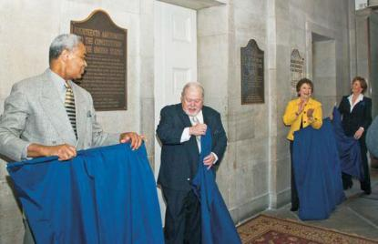 African American Heritage Commission Chair Harry Harrison, Historical Commission Chair Jerry Cashion, Secretary of Cultural Resources Linda Carlisle and N.C. Council of Women Executive Director Jill Dinwiddie unveil plaques commemorating ratification of the Thirteenth, Fourteenth, Fifteenth and Nineteenth Amendments to the United States Constitution.