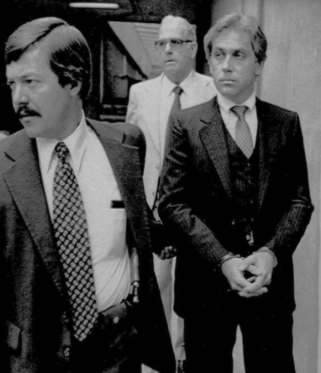 MacDonald is led away in handcuffs from Federal Court in Raleigh in 1979 after his conviction