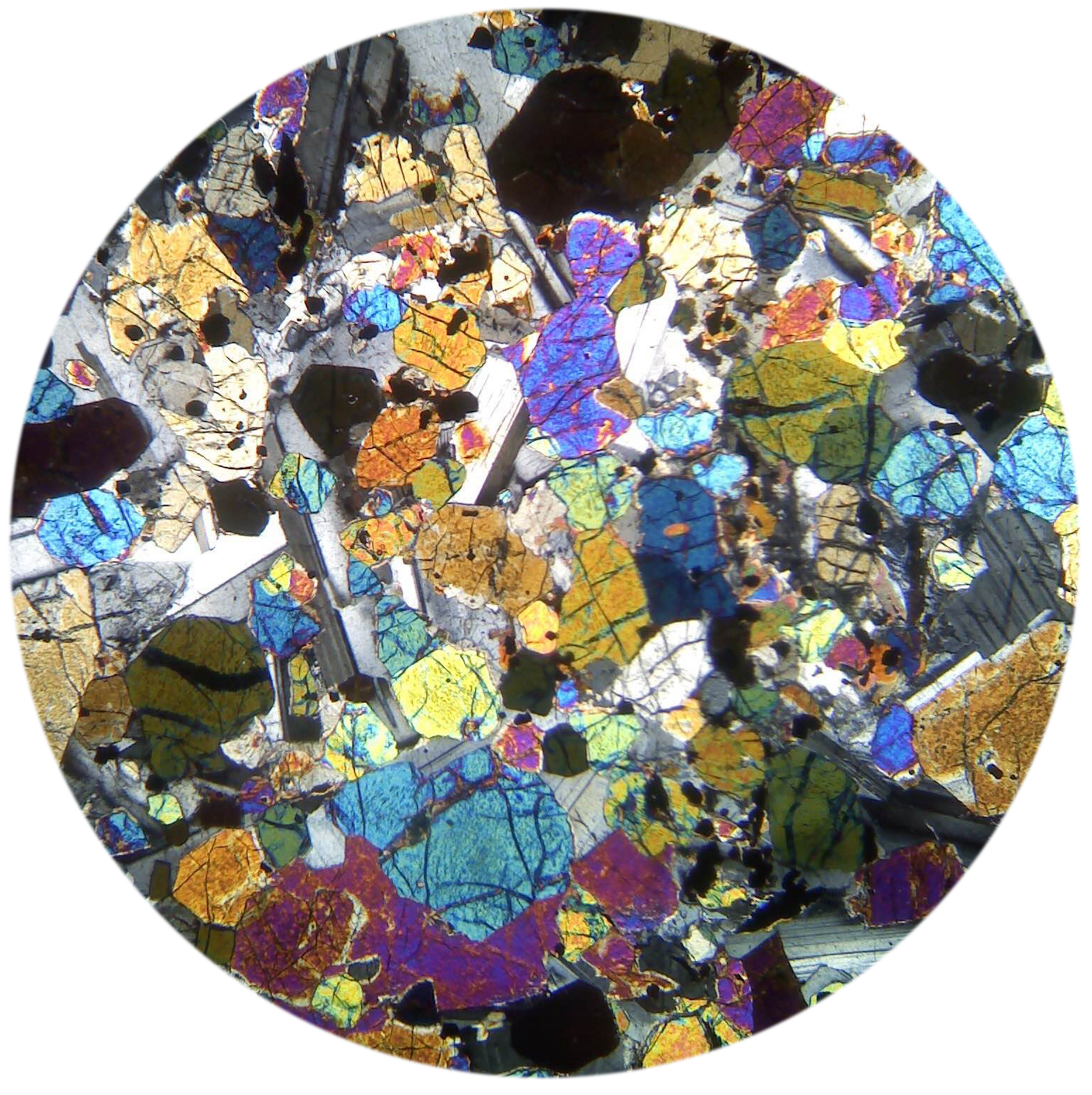 A thin section of a peridotite viewed through the cross-polarized light of a petrographic microscope.