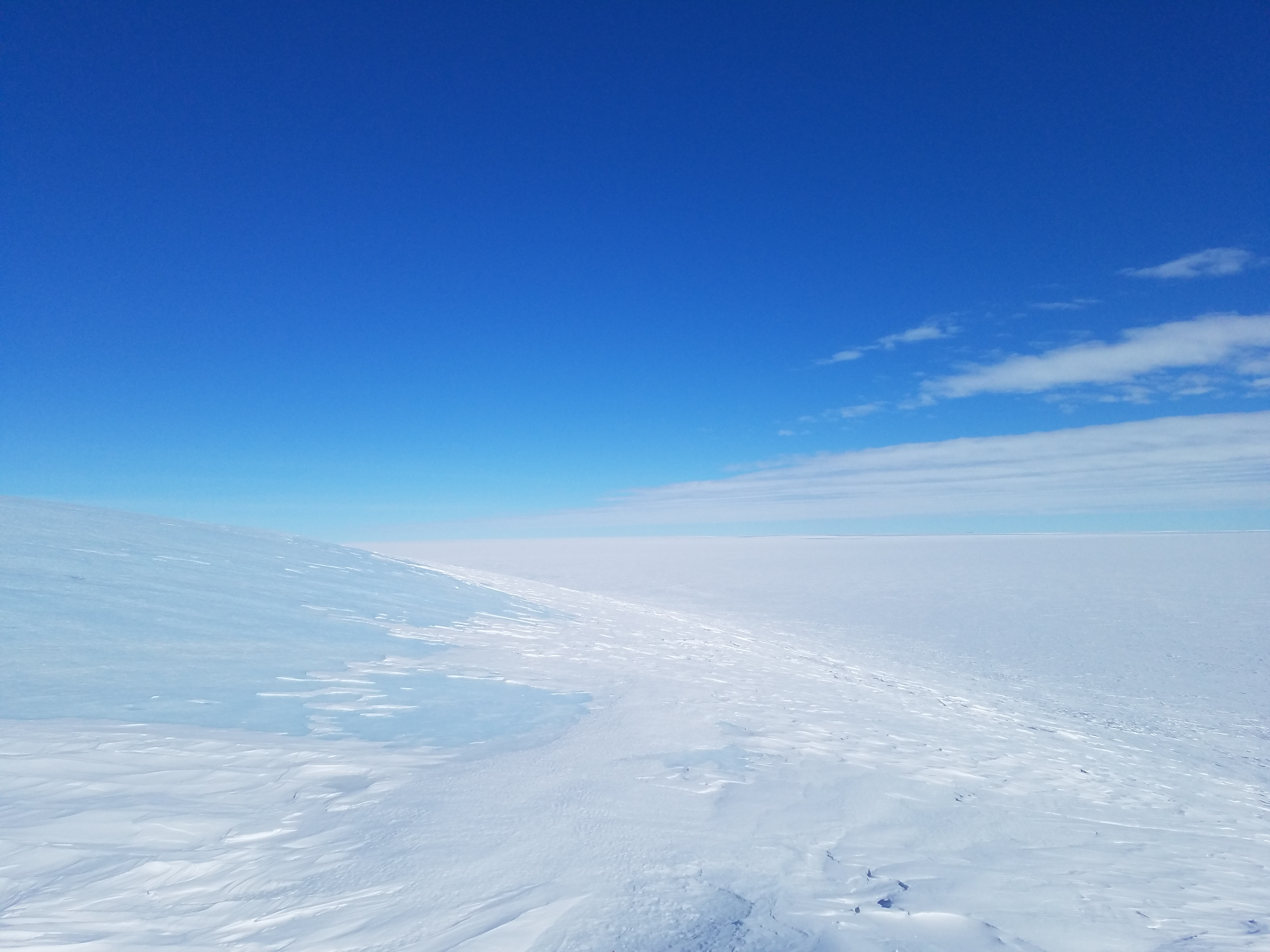 Ancient blue ice of the West Antarctic Ice Sheet covered in drifting snow.