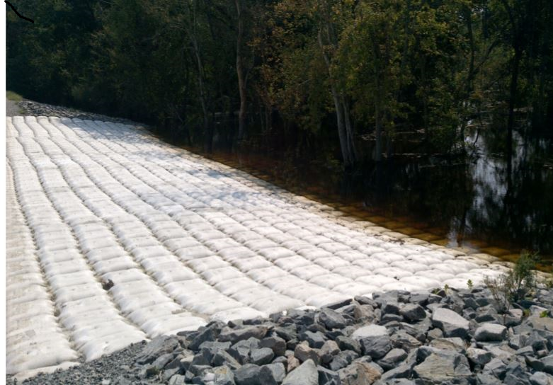 Newly constructed spillway at cooling pond dike wall