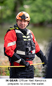 Officer Neil Kendrick prepares to cross the water