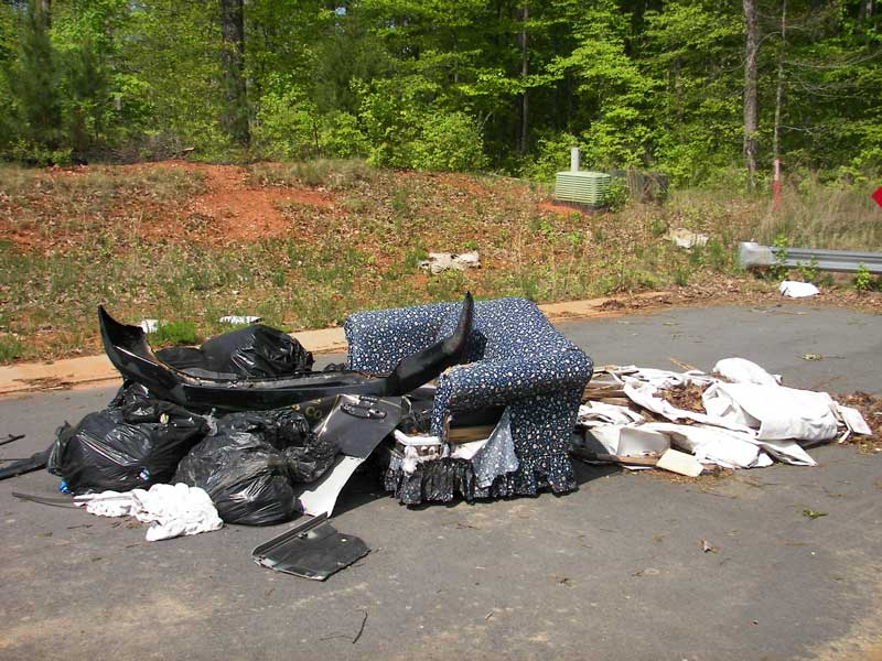 Illegally disposed of trash on the road
