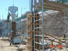 Placing concrete in to wood forms to make parking structure columns.