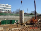 Caisson sleeve being moved to newly drilled caisson
