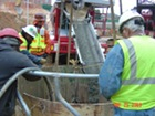 Concrete being poured into caisson directly from concrete truck
