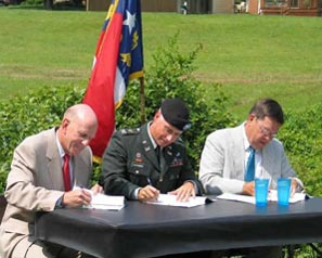 On July 22, 2003, (left to right) NCDENR Secretary Bill Ross, U.S. Army Corps of Engineers Col. Charles Alexander and NCDOT Secretary Lyndo Tippett sign the three-party Memorandum of Agreement that established the procedures of NCEEP.