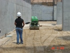 A compacting machine is operated by remote control before the slab is poured.
