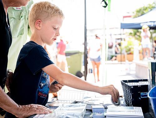 kid reaching for DMF sticker