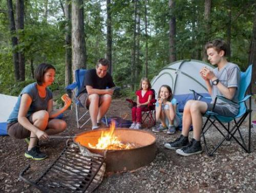 Camping family around a campfire
