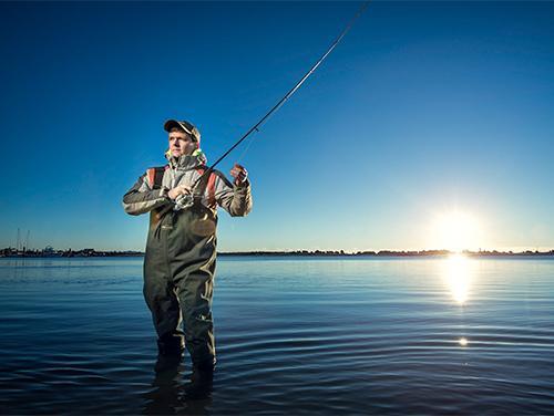 wade fishing at sunrise
