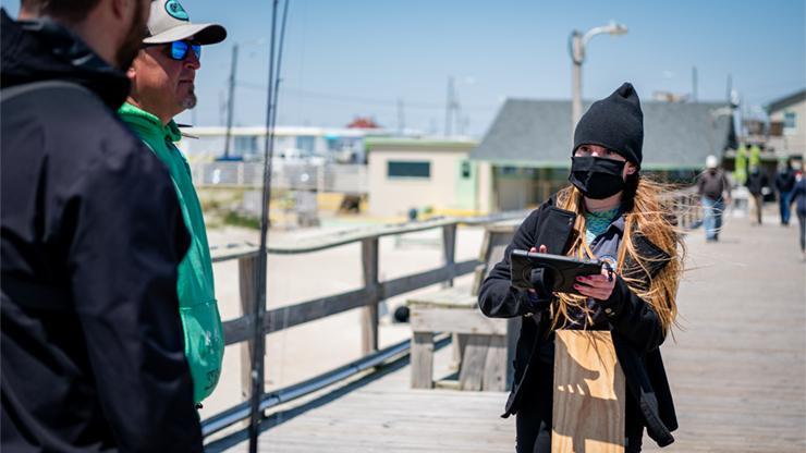 Recreational port agent interviewing fishermen