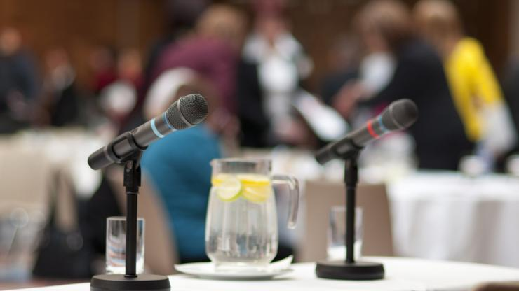 Microphones on a table for a public meeting.