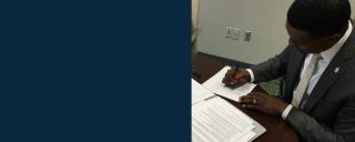 DEQ Secretary Michael Regan signs Consent Order on Feb. 25, 2019