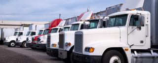 row of parked tractor trucks