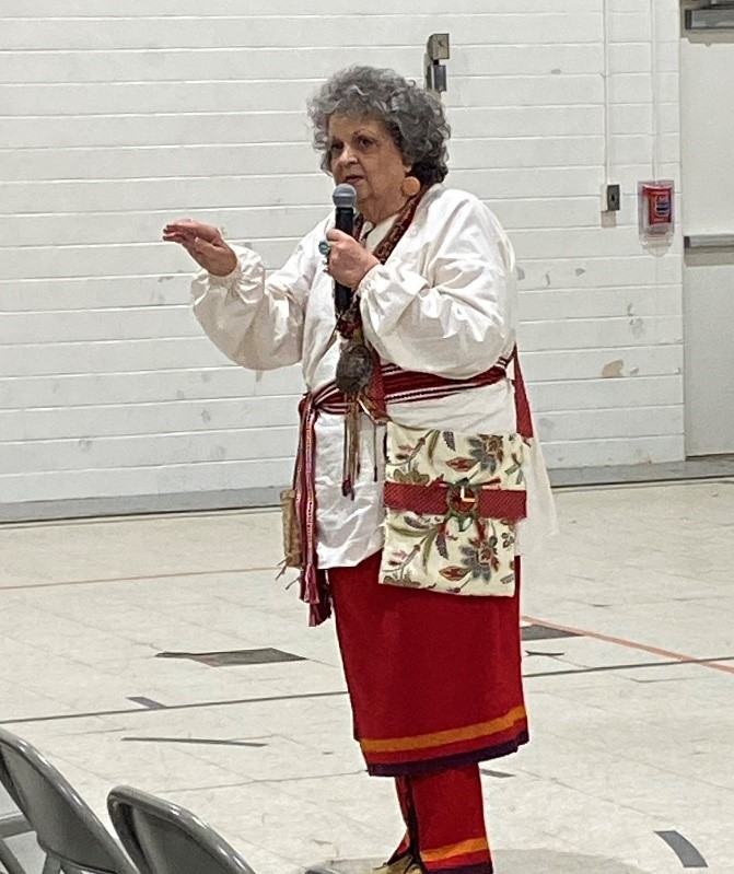 In the tradition of Native American storytelling, Kat Littleturtle tells the audience a story about a woman who led a tribe to a battle victory.