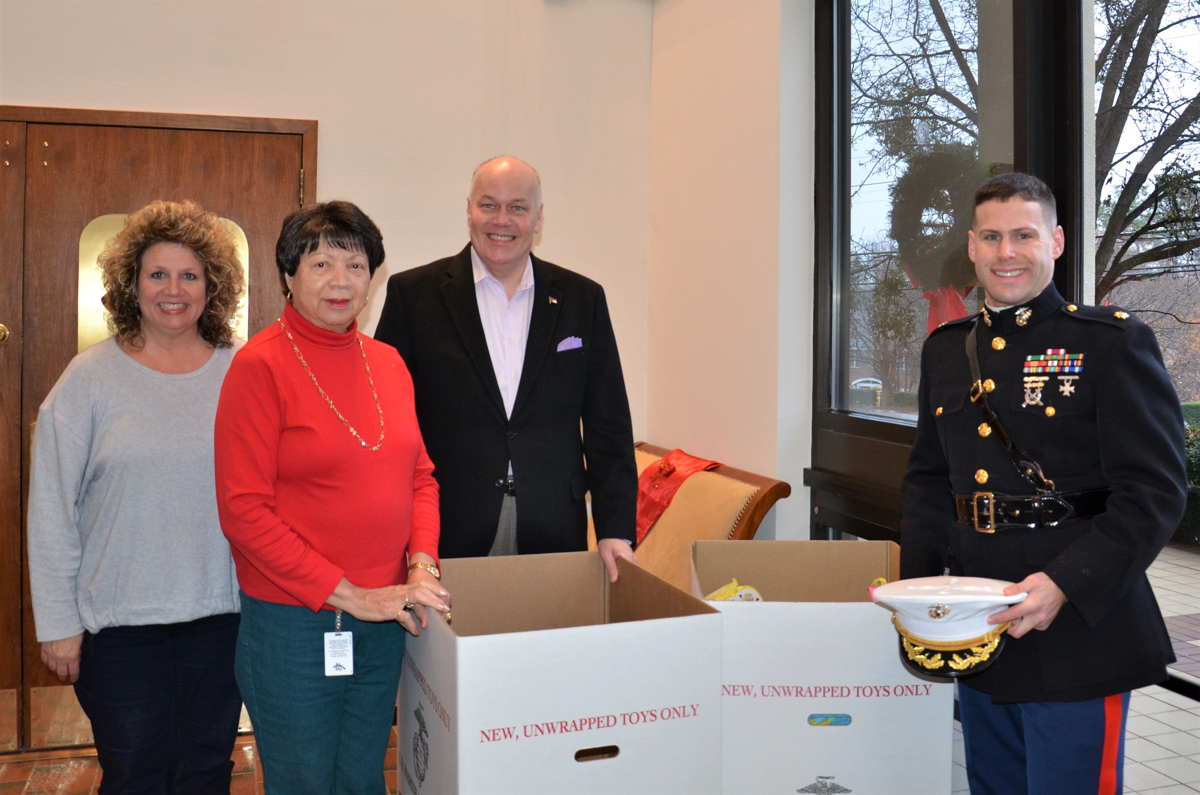 Division of Public Health Emplyoees (right to left) Carla Moore, Betty Baker, Mark Benton and Maj. Brad Brecher, USMCR, helped collect toys for Toys for Tots