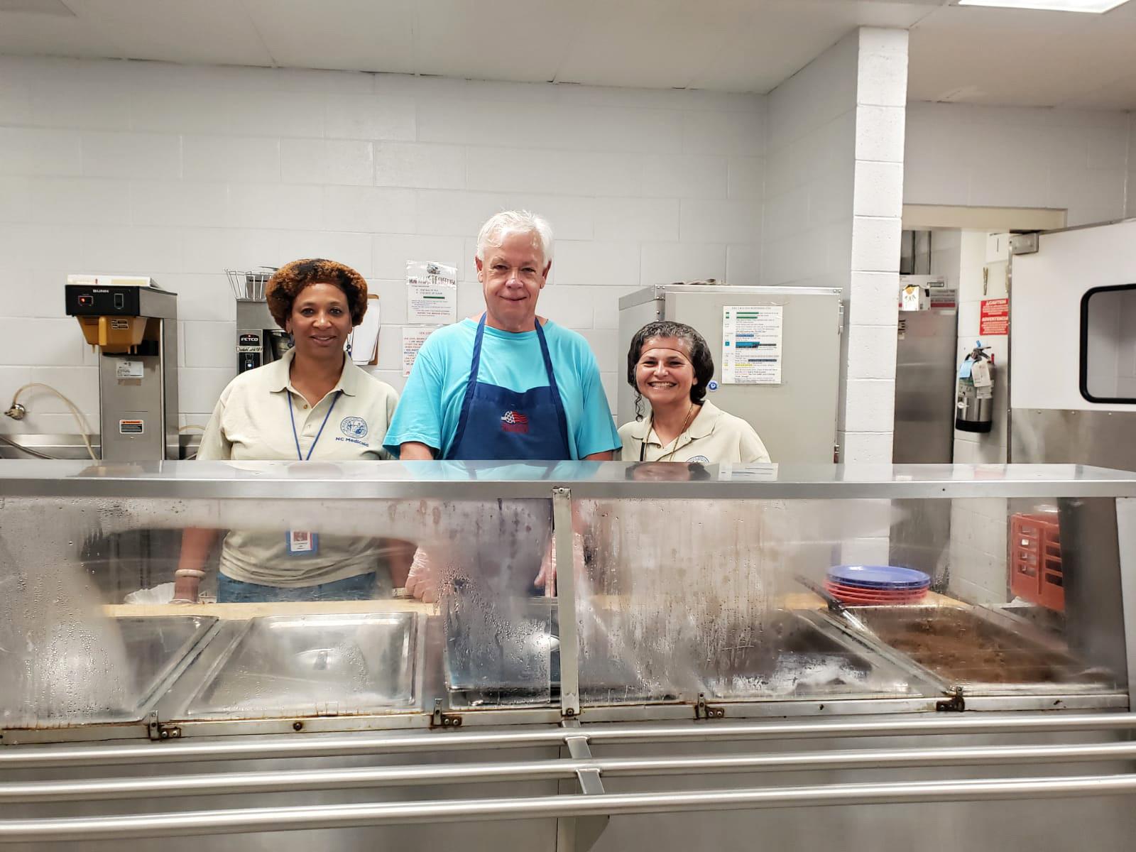 NC Medicaid employees serving food at Healing Transitions.