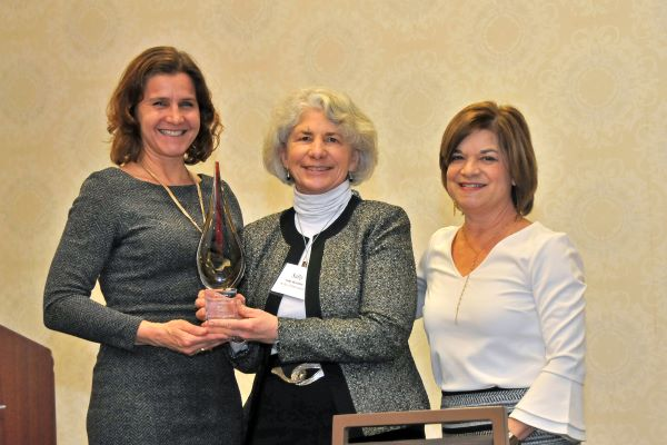 Sally Herndon (center) is presented with the Ronald H. Levine Legacy Award by State Health Director and DHHS Chief Medical Officer Elizabeth Tilson (left) and Division of Public Health Acting Director Beth Lovette.