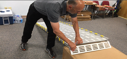 Consultant demonstrating portable ramp