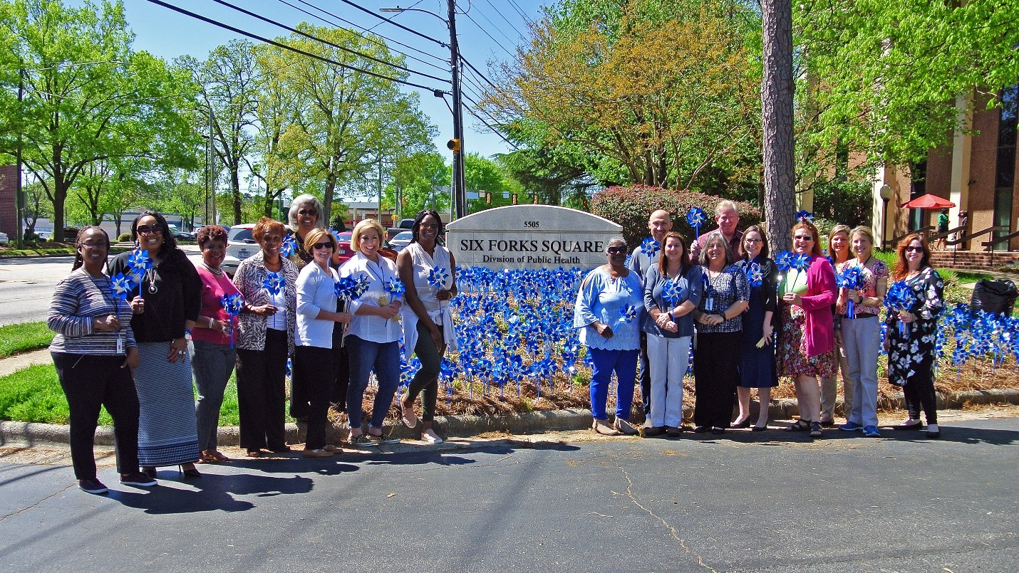 Staffers at DPH participated in a Pinwheels for Prevention planting on April 16.