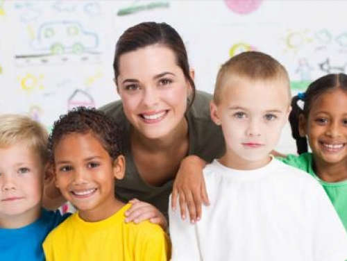 Teacher smiling with students