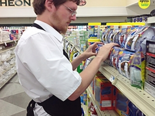 Blind Man Stocking Grocery Store Shelf