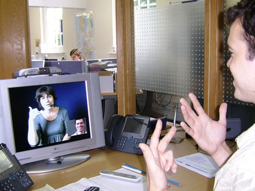 man using video relay service