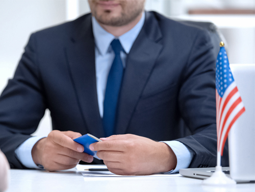 man at desk with passport