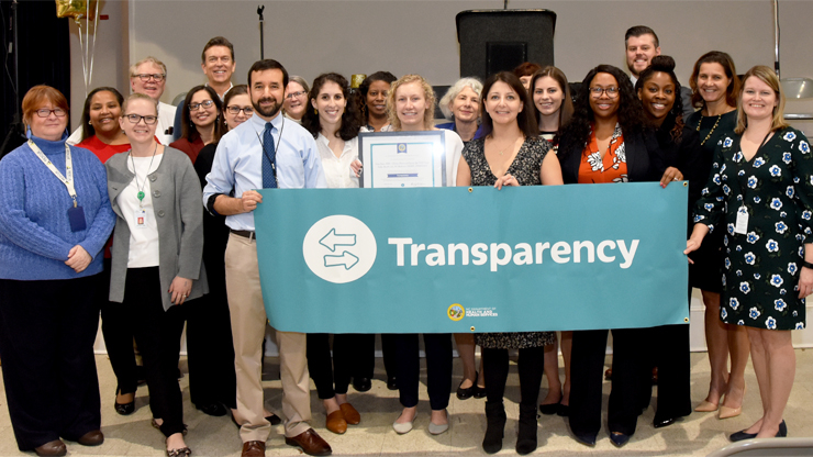 The Youth and Adult Tobacco Prevention Team, a recipient of a Team Recognition Award in the Transparency category, with DHHS Secretary Mandy Cohen.