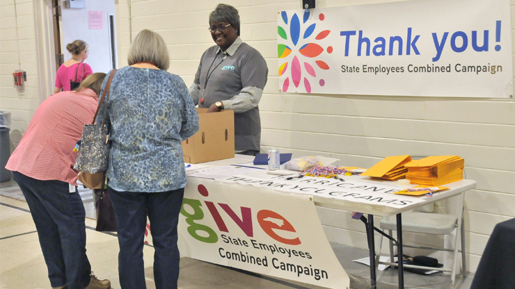 """DHHS employees put the SECC """"Power of Giving"""" into action at the SECC and First Friday celebration at Haywood Gym on Nov. 2. Ten charities were on hand, and the event featured food trucks, prize drawings and more."""