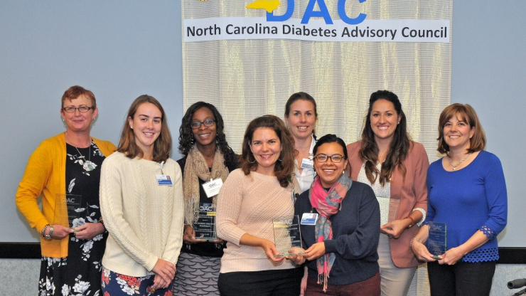 North Carolina Diabetes Advisory Council Award recipients for 2018 include: Susan Houston of Vidant Health (far left); Ahunna Freeman of Southside Discount Pharmacy (third from left); Rachel Marquez (second from right); Melissa Herman, FirstHealth of the Carolinas (far right); and members of the Healthy Communities Department at Cone Health (center).