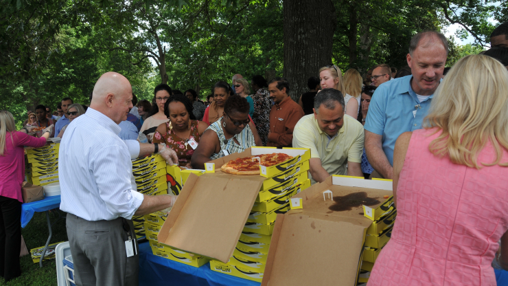 DHHS employees receiving pizza during employee recognition event.