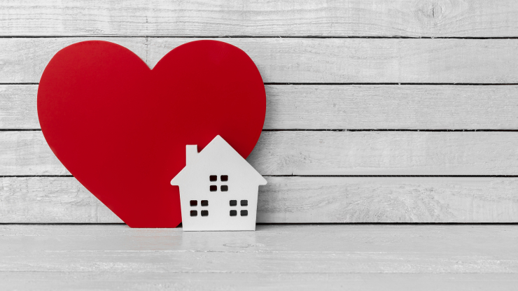 Heart with house in front of it.