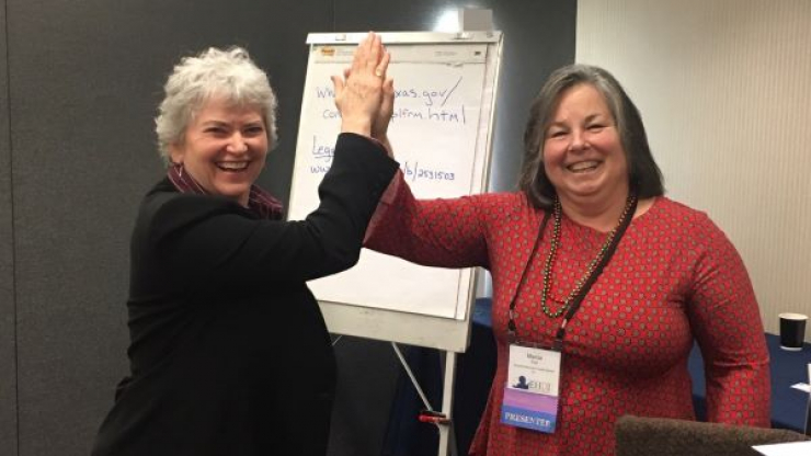 DSDHH Director Jan Withers and EHDI Coordinator Marcia Fort celebrate their partnership at the National Early Hearing Detection and Intervention Conference.