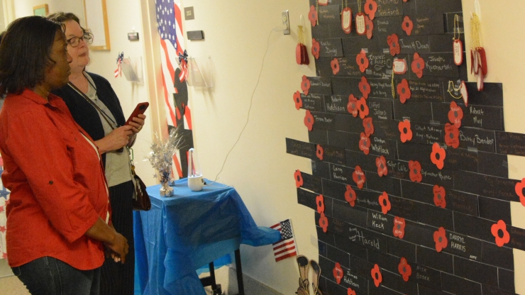 The Wall of Remembrance created by members of the Medicaid Provider Services team to honor military personnel killed in action and deceased veterans.