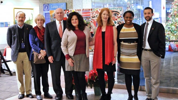 Communicable Disease Branch staff are joined by University of North Carolina's Dr. Mike Cohen (third from left) at a ceremony commemorating World AIDS Day in Raleigh.