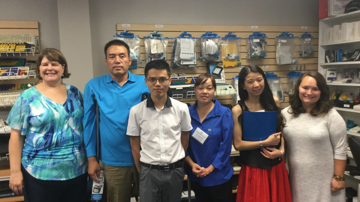 Chinese Visitors at Charlotte AT Center with Staff