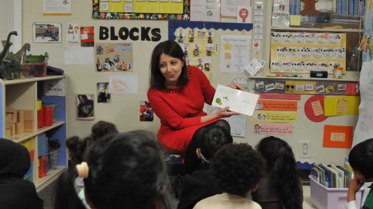 Secretary Mandy Cohen reads to children at a Raleigh preschool for Week of the Young Child.