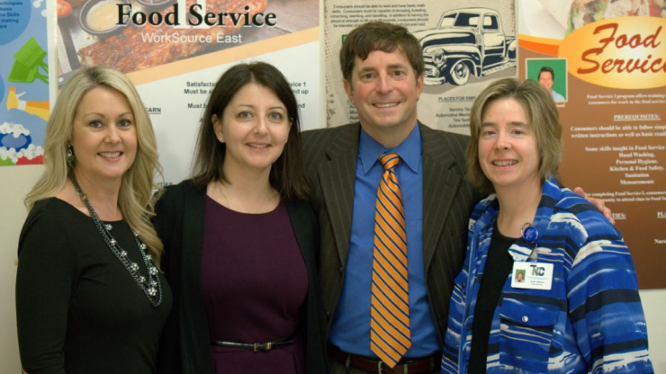 Division of Vocational Rehabilitation Services Director Tara Myers, DHHS Secretary Mandy Cohen, M.D., N.C. Council on Developmental Disabilities Executive Director Chris Egan, and WorkSource East Facility Director Jackie Tetterton.