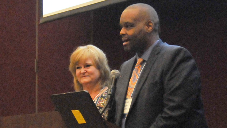 DHHS Assistant Secretary for Human Services Michael Becketts gives opening remarks at a meeting on the Family First Prevention Services Act with NC Association of County DSS Directors President Donna Fayko, right.