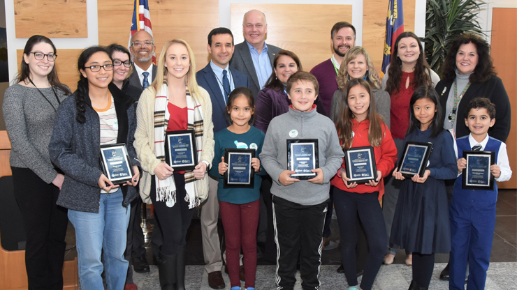 Poster contest winners were awarded their plaques on Nov. 15 by DHHS staff and leadership.