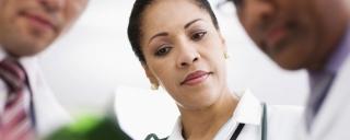 Doctors looking at patient
