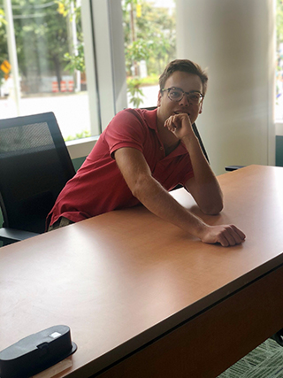Harrison Jordan sits at a desk