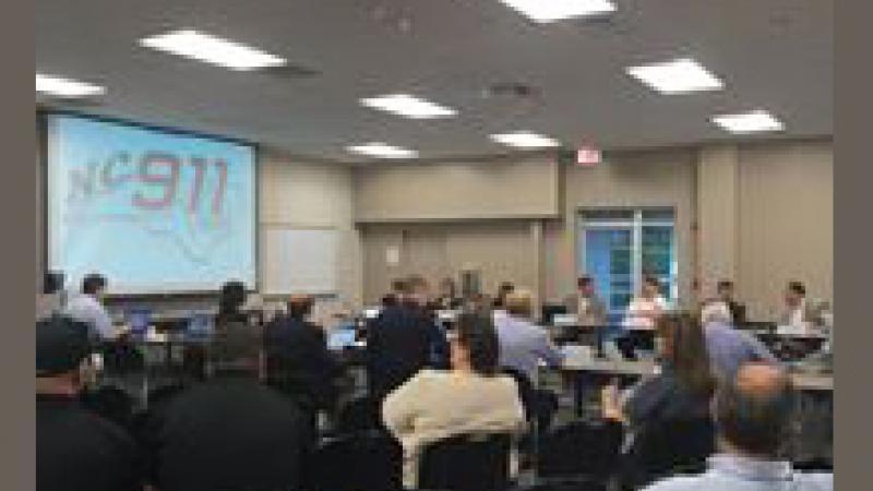911 Board members attending meeting