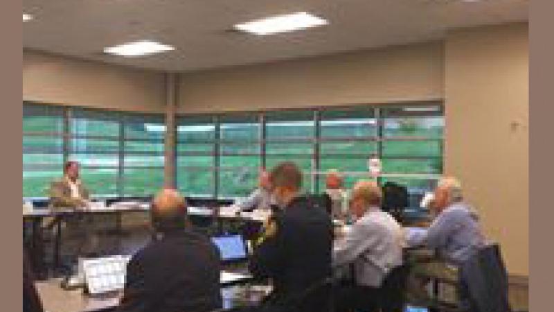 911 Committee members attending a meeting